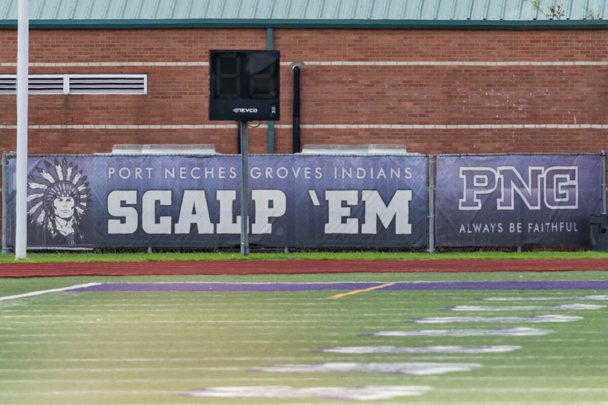 A banner along the Port Neches-Groves field house inside the football stadium with the Indians mascot logo and the battle cry to