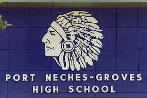 A sign with the Indians mascot logo on the outside of the Port Neches-Groves high school over one of the entrances. Photo made on July 9, 2020. Fran Ruchalski/The Enterprise
