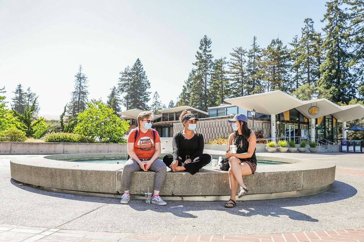 (L-r) UC Berkeley students Ashley Lee ,20, Alina Flowers, 20, and Chayanin Suksunpantep, 20, chat as they relax together on campus on Wednesday, July 8, 2020 in Berkeley, California.