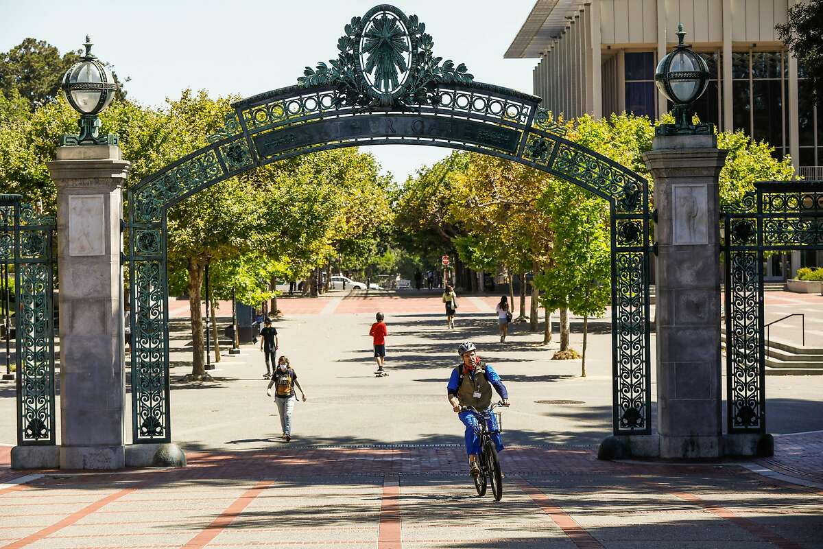 People walk through the UC Berkeley campus on July 8. UC Berkeley officials lifted a two-week lockdown in the dorms Tuesday.