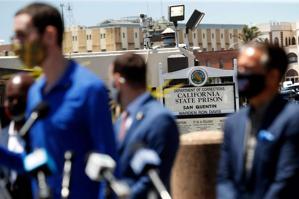Elected officials, including State Senator Scott Wiener (left), join protesters demanding Governor Gavin Newsom release inmates from coronavirus-ravaged San Quentin prison in San Quentin, Calif., on Thursday, July 9, 2020.