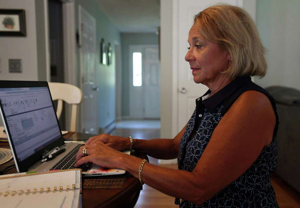 Carole Ardito, president of the North Haven Education Association, the teachers union in North Haven, works on preparations for the new school year at her home in Branford, Conn. on Thursday, July 9, 2020.
