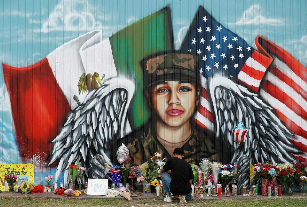 Juan Cruz, boyfriend of Army Pfc. Vanessa Guillén, kneels in front of a mural honoring her on Sunday, July 5, 2020, in Houston. Guillén, 20, who went missing in April was presumably killed by a fellow soldier.