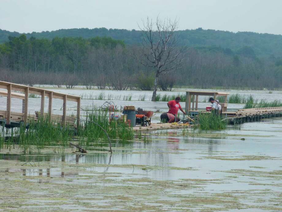 Work has begun to raise sections of walkway at the Arcadia Marsh Preserve which have been impacted by historic high water levels in 2020. (Scott Fraley/News Advocate)