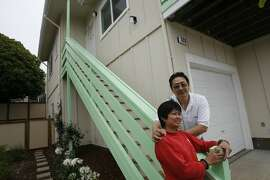 Ben Ong and Virginia Tan in front of their Habitat for Humanity home in Daly City in 2006. The Bay Area chapter of the organization is lobbying for SB899, a bill that would allow faith groups to build affordable housing on their own property with a streamlined approval process.