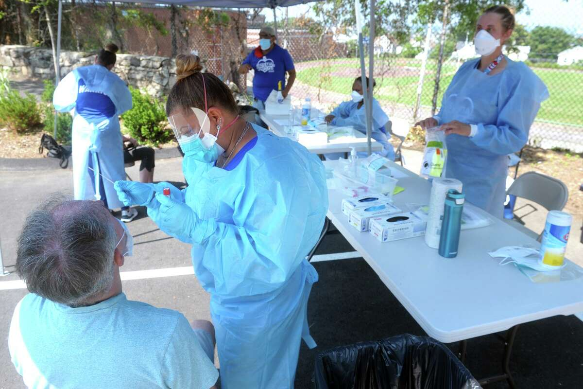 Hundreds of people turned out Thursday morning for COVID-19 tests at Liberation Programs, in Bridgeport, Conn. July 9, 2020. The free community Coronavirus test screenings were administered by the staff of Bridgeport's Southwest Community Health Center.