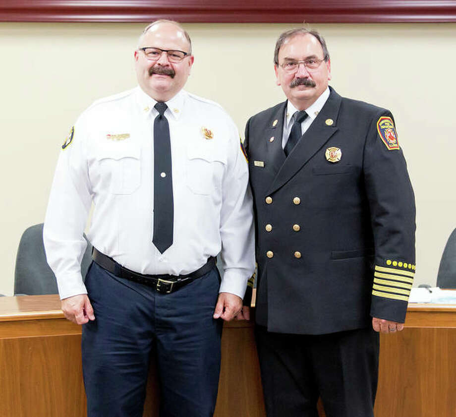 Dep. Fire Chief James Whiteford, left, will become the city's new fire chief Monday as he succeeds Fire Chief Rick Welle, right. Photo: Courtesy Of The Edwardsville Fire Department