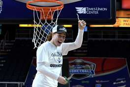 Quinnipiac forward Jen Fay, the tournament most valuable player, cuts down the net after defeating Marist in the 2019 Metro Atlantic Athletic Conference women's tournament championship game. Fay was named an assistant coach with the Bobcats on Friday.