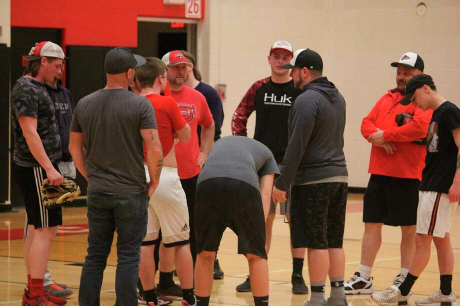 Reed City coach Eric Grannis and his players talk during a preseason baseball practice priorto the cancellation because of COVID-19. Grannis is currently doing summer workouts with his players. (Pioneer file photo)