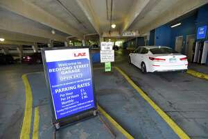 """A car enters the Bedford Street Garage in Stamford, Connecticut on July 9, 2020. Mayor David Martin, along with U.S. Congressman Jime Himes and David Kooris, President of Stamford's Downtown Special Services District, announce a new initiative designed to incentivize residents to visit downtown and support local businesses offering the use of a promotional code """"WearAMask"""" for three hours of free parking in City garages when they use the Parkmobileapp."""