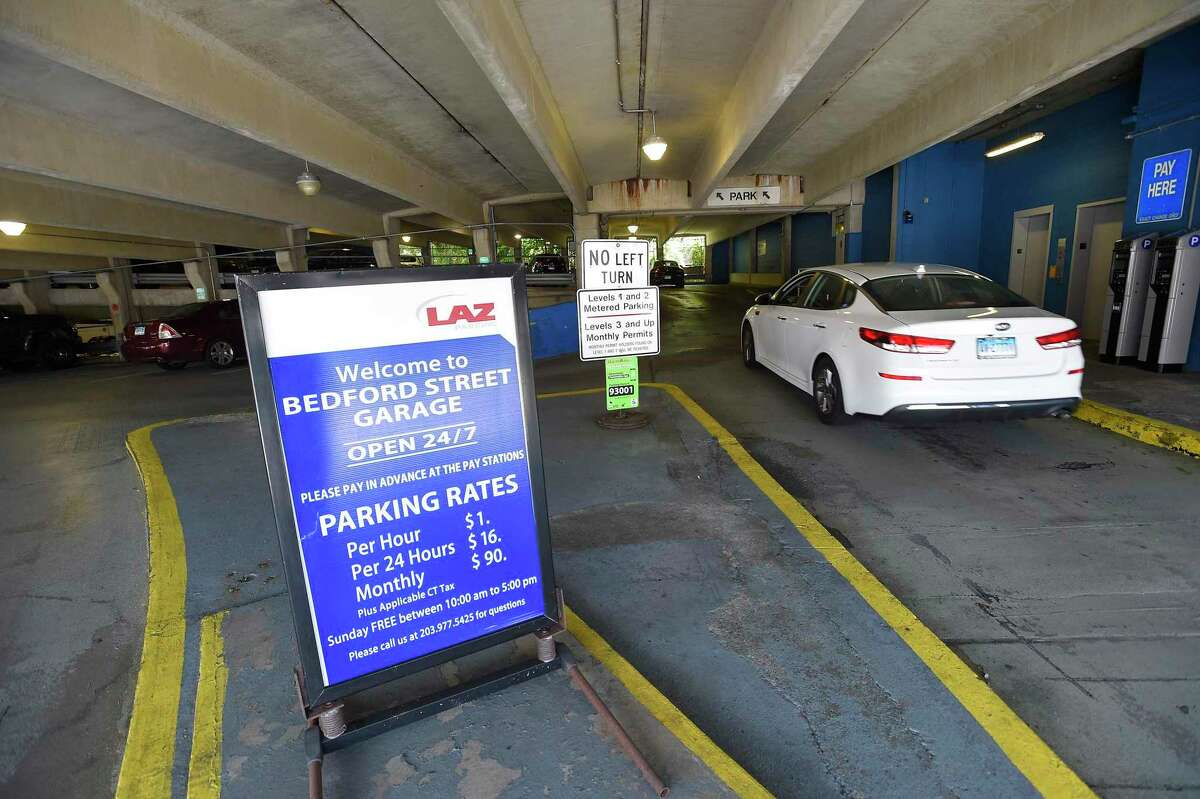 A car enters the Bedford Street garage in Stamford on July 9. Mayor David Martin, along with U.S. Rep. Jim Himes and David Kooris, president of Stamford's Downtown Special Services District, announced an initiative to incentivize residents to visit downtown and support local businesses.