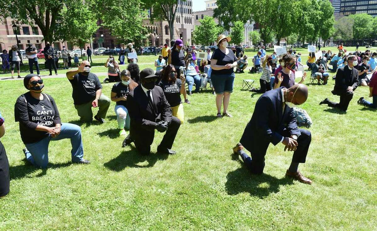 People gather for The Prayer, Protest & Peace March on the New Haven Green on June 14.