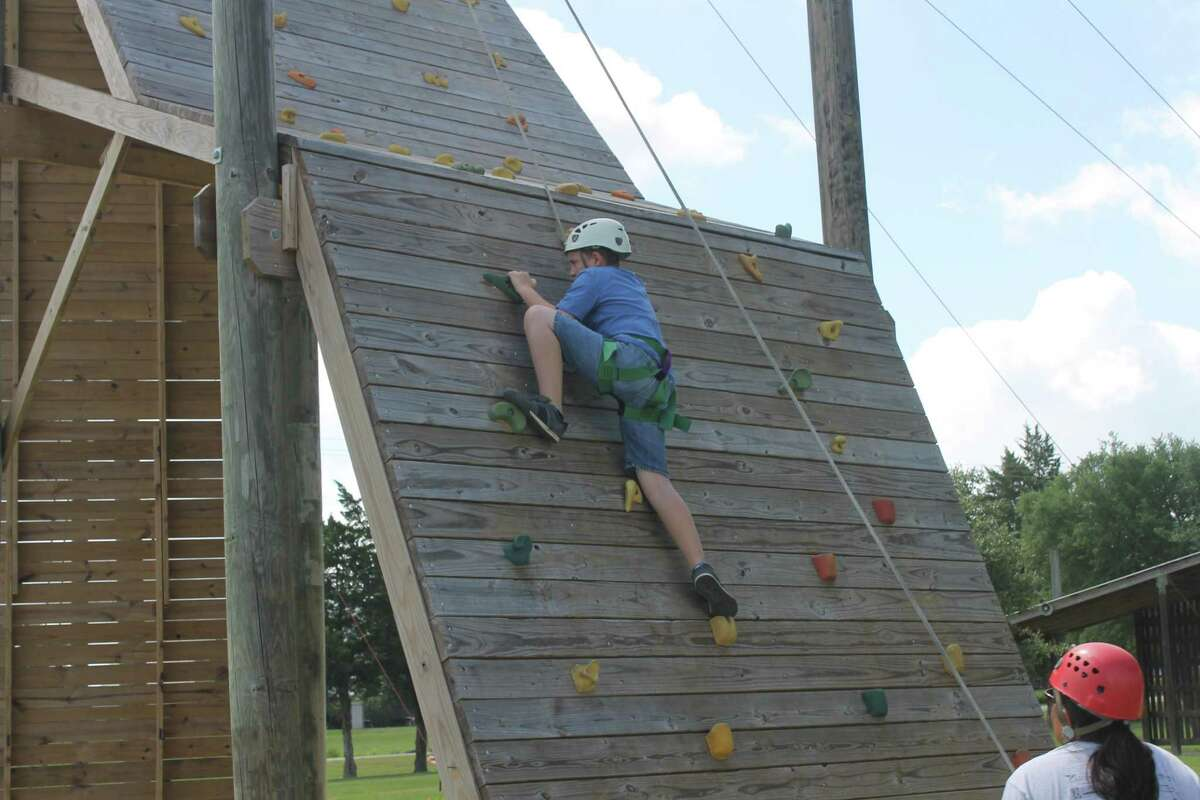 Camp For All, a nonprofit camp in Burton, Texas, that operates January through November each year, has taken its camps and activities for children, teens and adults with challenging illnesses and special needs online due to COVID-19. Here, a camper braves a challenge course at Spike 'n' Wave camp before the pandemic hit.