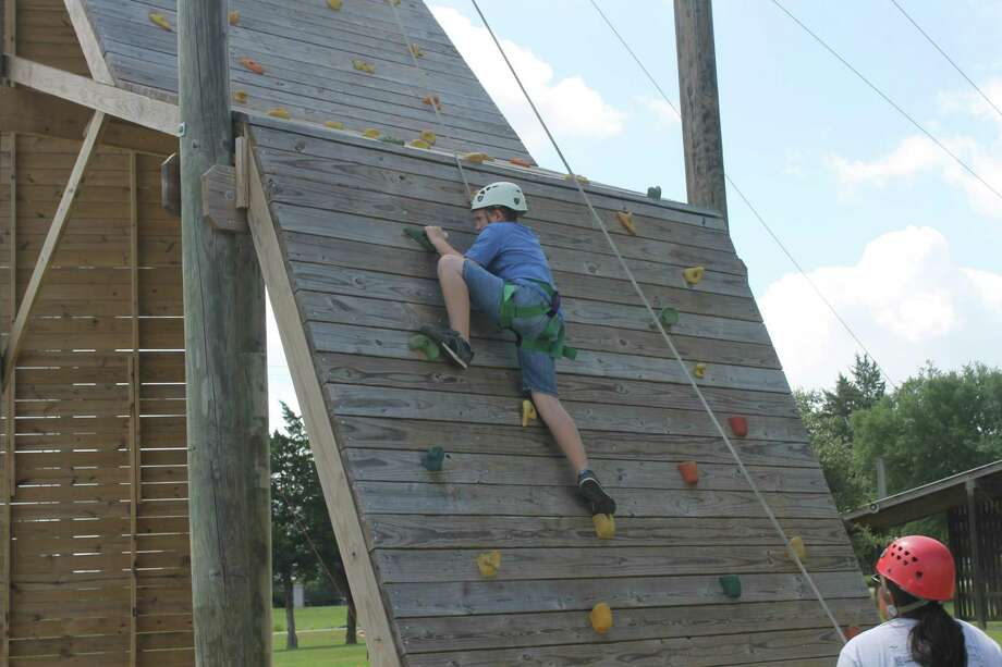 Camp For All, a nonprofit camp in Burton, Texas, that operates January through November each year, has taken its camps and activities for children, teens and adults with challenging illnesses and special needs online due to COVID-19. Here, a camper braves a challenge course at Spike 'n' Wave camp before the pandemic hit. Photo: Courtesy Of Camp For All