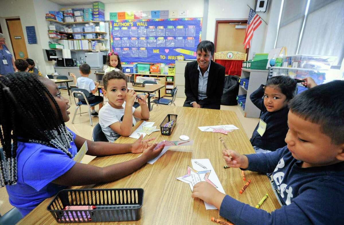 Superintendent Tamu Lucero chats with kindergarteners in Miss Melissa Sempey's class at KT Murphy School, during a visit on the first day of school on August 29, 2019 in Stamford.