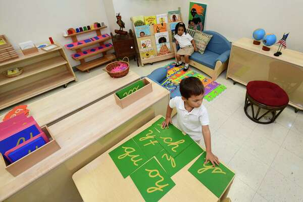 Students get busy during their first day of school in one of the two new Montessori classrooms at Brookside Elementary School Tuesday, August 27, 2019, where new interim principal James Crouch is starting and new prek Montessori classrooms are opening at the school in Norwalk, Conn.