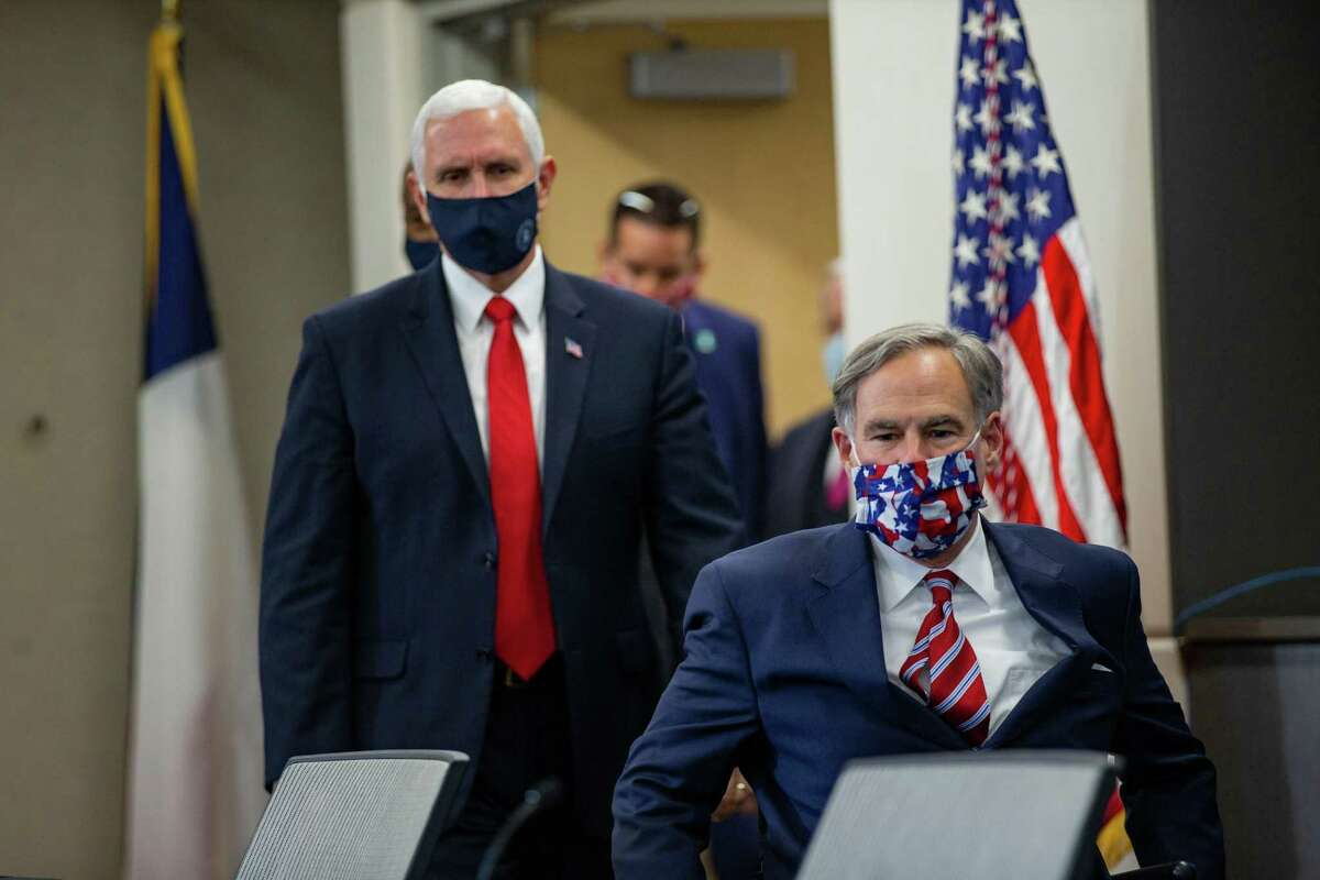 Vice President Mike Pence (left) and Gov. Greg Abbott walk in before a press gaggle on the coronavirus pandemic at University of Texas Southwestern Medical Center on Sunday, June 28, 2020, in Dallas. (Juan Figueroa/The Dallas Morning News/TNS)