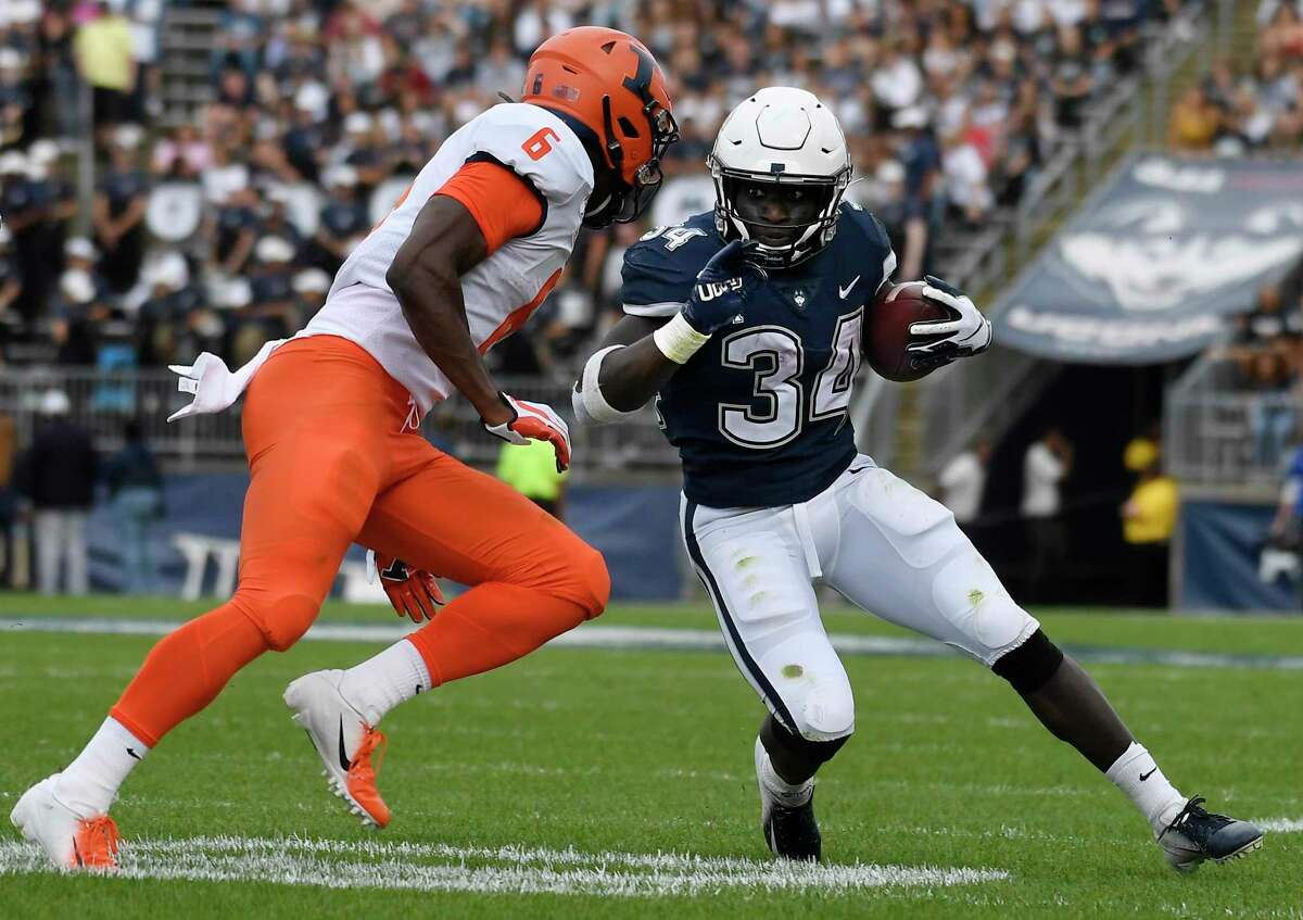 UConn running back Kevin Mensah (34) is pursued by Illinois's Tony Adams (6) in September. The Big Ten's decision to only play conference games this season in response to the pandemic means the teams wont meet again this year.