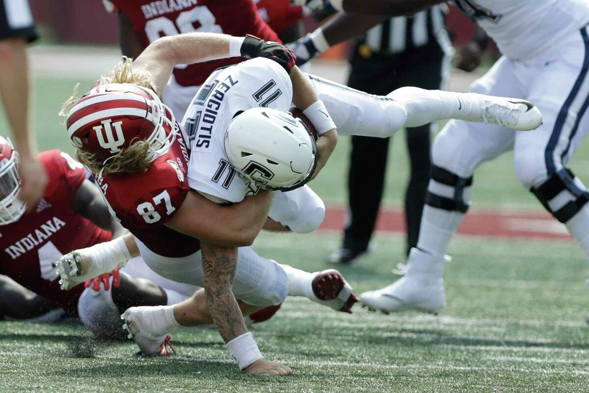 UConn quarterback Jack Zergiotis (11) is sacked by Indiana defensive lineman Michael Ziemba (87) in September. The Big Ten's decision to only play conference games this season in response to the pandemic means the teams wont meet again this year.