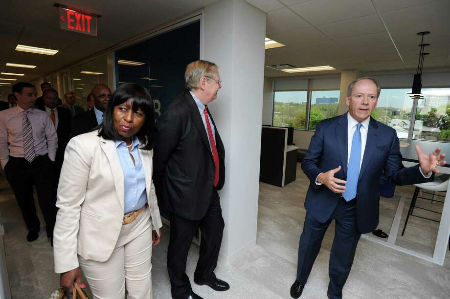 President of ISG Americas Todd Lavieri, right, gives a tour of the IT consulting and research firm's new offices at 2187 Atlantic St., in Stamford, Conn., on May 9, 2018. Also pictured are Stamford mayor David Martin, center, and Rep. Gloria DePina (D-5). Photo: Michael Cummo / Hearst Connecticut Media / Stamford Advocate