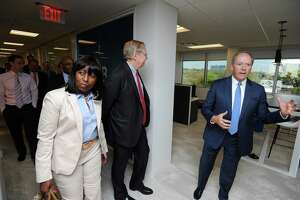 President of ISG Americas Todd Lavieri, right, gives a tour of the IT consulting and research firm's new offices at 2187 Atlantic St., in Stamford, Conn., on May 9, 2018. Also pictured are Stamford mayor David Martin, center, and Rep. Gloria DePina (D-5).
