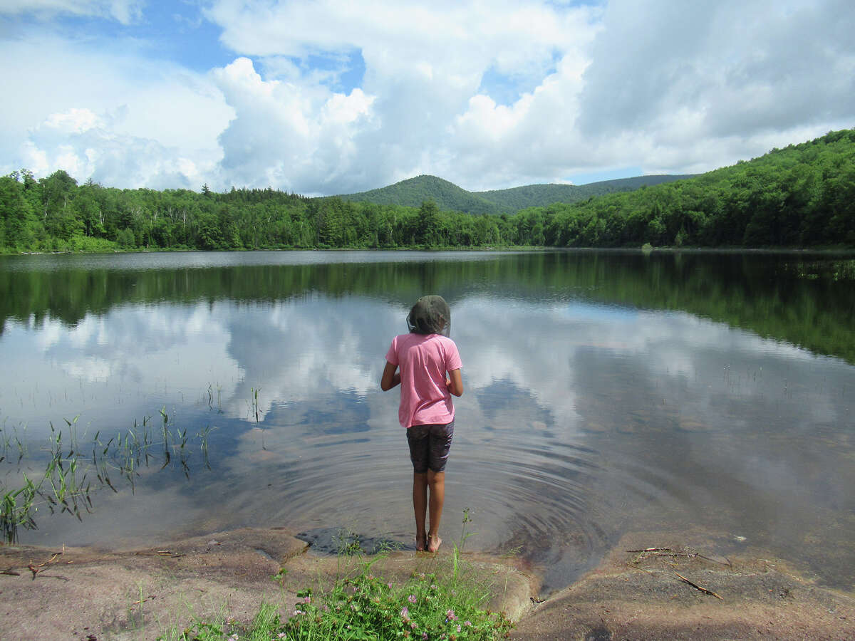 Herb Terns' daughter enjoys the view east across Clear Pond in the Siamese Pond Wilderness. (Herb Terns / Times Union)