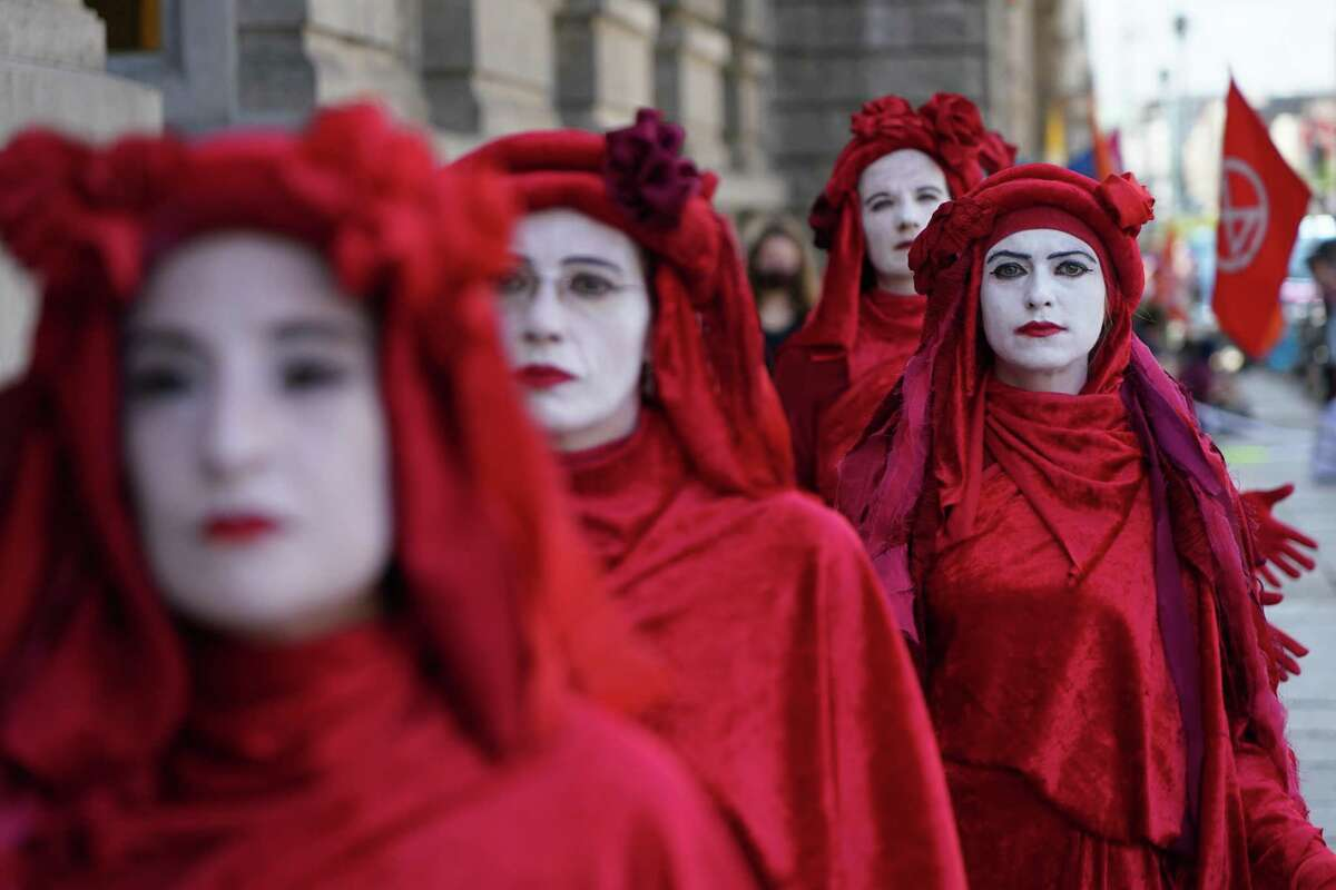 Supporters of the Extinction Rebellion climate change protest movement, including figures known as the Red Brigade, blockade the entrance to the German Association of the Automotive Industry (VDA) on June 17, 2020 in Berlin, Germany. Extinction Rebellion is organizing a series of demonstrations nationwide this week in order to bring attention to the need for swift and effective measures to slow global warming.