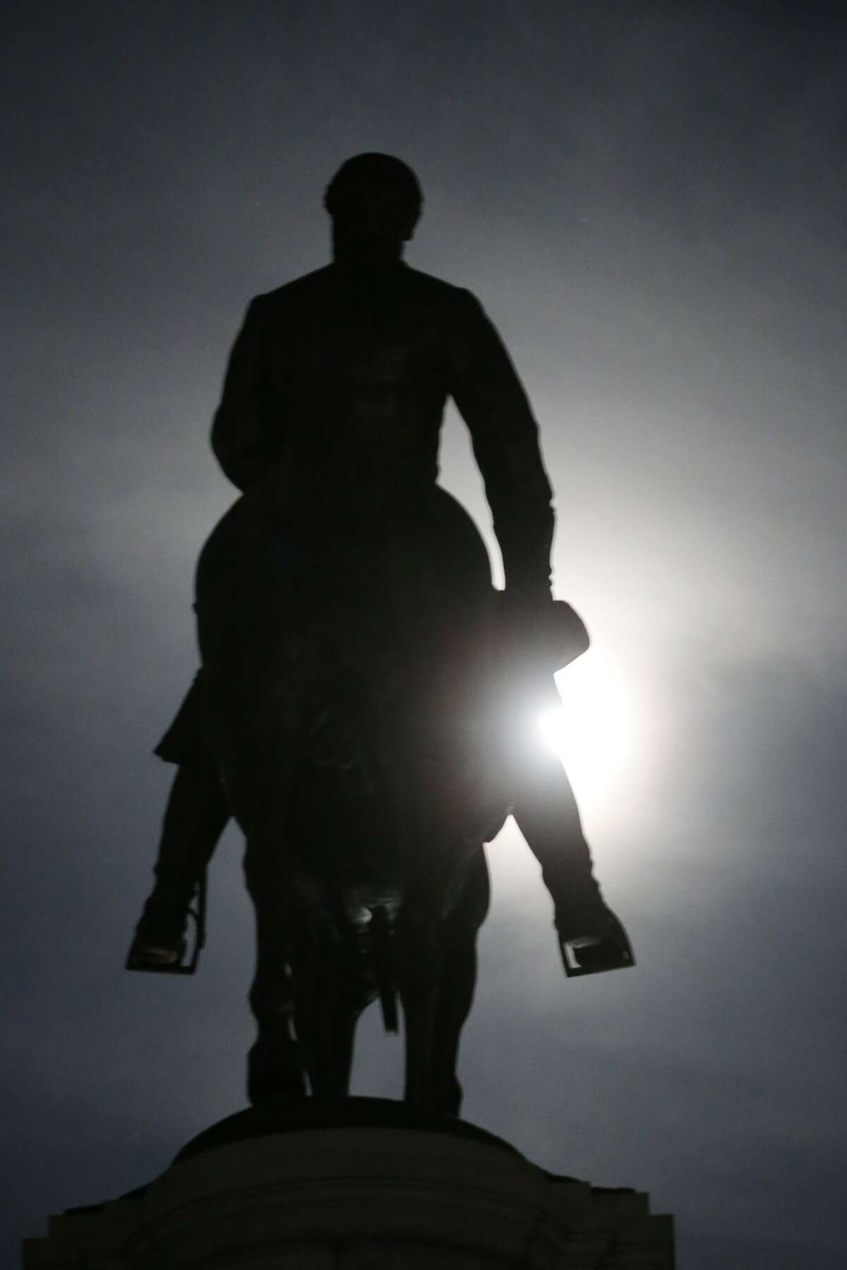 FILE This Friday June 5, 2020 file photo shows the Moon as it illuminates the statue of Confederate General Robert E. Lee on Monument Avenue in Richmond, Va. Virginia Gov. Ralph Northam has ordered the removal of the statue. (AP Photo/Steve Helber)