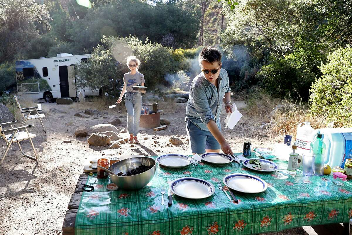 Daniel Miller and his wife, Jessica MacKenzie, left, prepare dinner while RVing at Wheeler Gorge campground in the Los Padres National Forest on June 10, 2020, in Ojai, California. (Gary Coronado/Los Angeles Times/TNS)