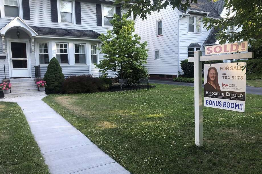 A sold sign hangs in front of a house in Brighton, New York, on Saturday, July 4, 2020. Photo: Ted Shaffrey, Associated Press
