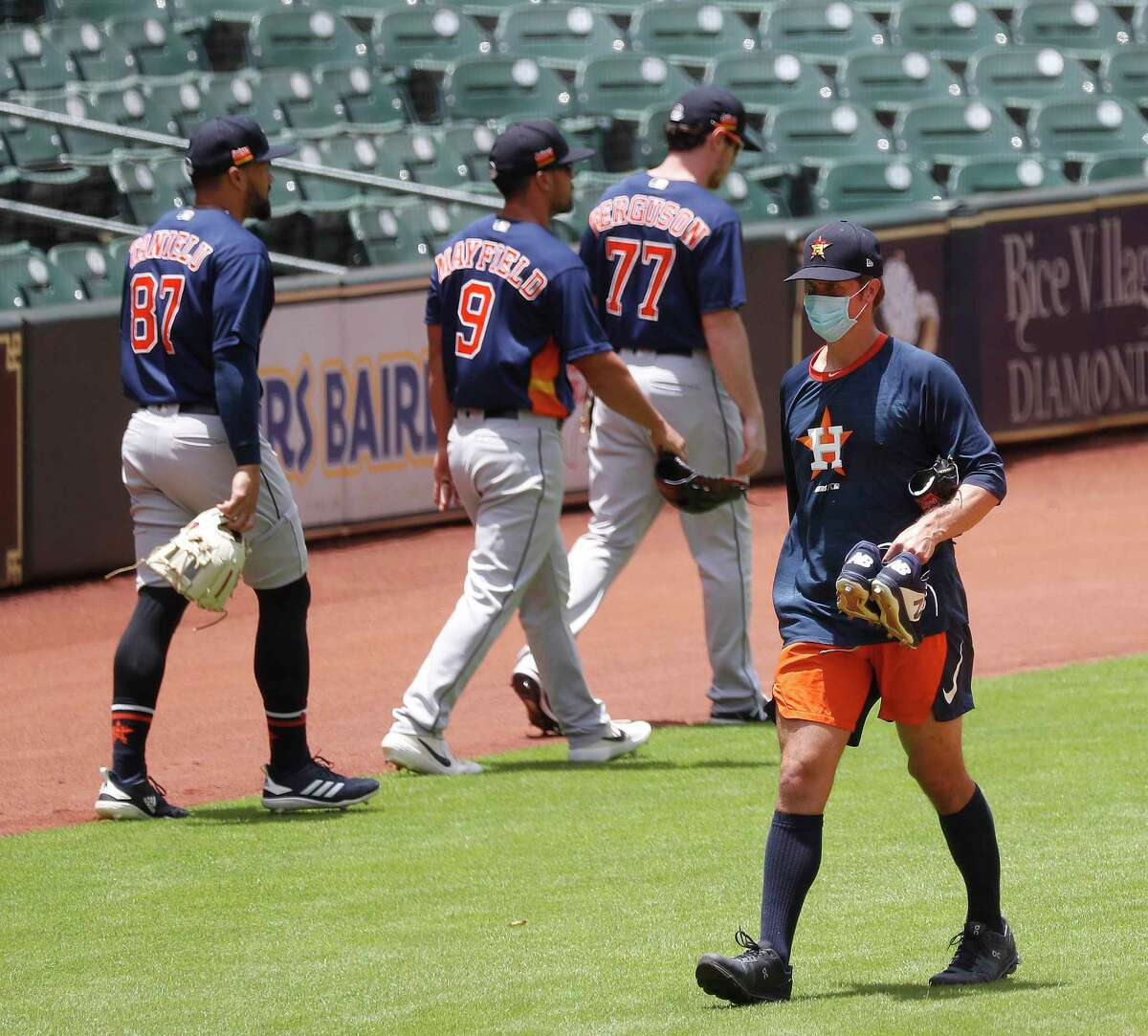Houston Astros pitcher Zack Greinke passes Drew Ferguson, Jack Mayfield and Nick Tanielu before the start of their intrasquad game during the Astros summer camp at Minute Maid Park, Thursday, July 9, 2020, in Houston.