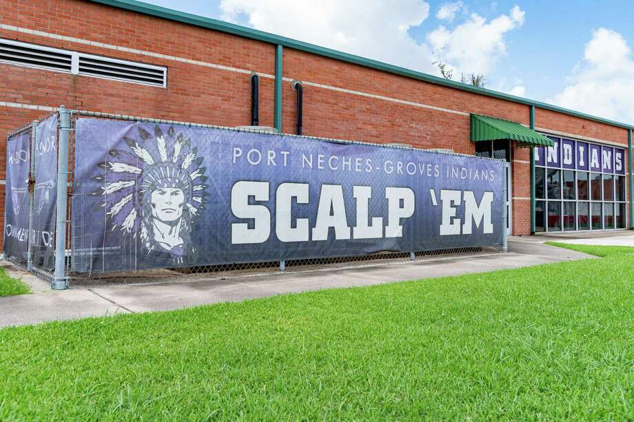 """A banner along the Port Neches-Groves field house inside the football stadium with the Indians mascot logo and the battle cry to """"Scalp 'Em."""" Photo made on July 9, 2020.  Fran Ruchalski/The Enterprise Photo: Fran Ruchalski, The Enterprise / The Enterprise / © 2020 The Beaumont Enterprise"""