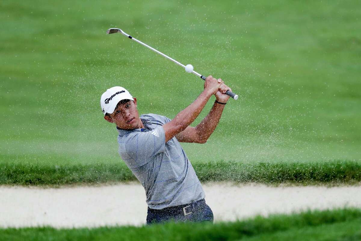 Coilin Morikawa hits from a bunker on the 18th hole during opening round of the Workday Charity Open golf tournament, Thursday, July 9, 2020, in Dublin, Ohio. (AP Photo/Darron Cummings)