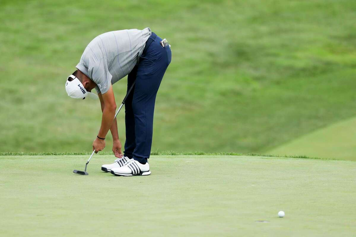 Coilin Morikawa reacts after missing a putt on the 18th hole during opening round of the Workday Charity Open golf tournament, Thursday, July 9, 2020, in Dublin, Ohio. (AP Photo/Darron Cummings)