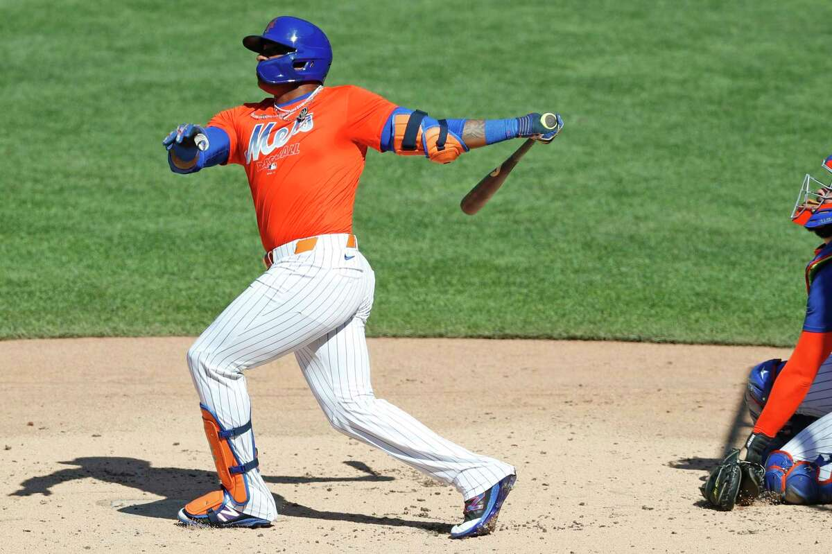 New York Mets' Yoenis Cespedes bats in a simulated game, part of the Mets summer baseball training camp workout at Citi Field, Thursday, July 9, 2020, in New York. (AP Photo/Kathy Willens)