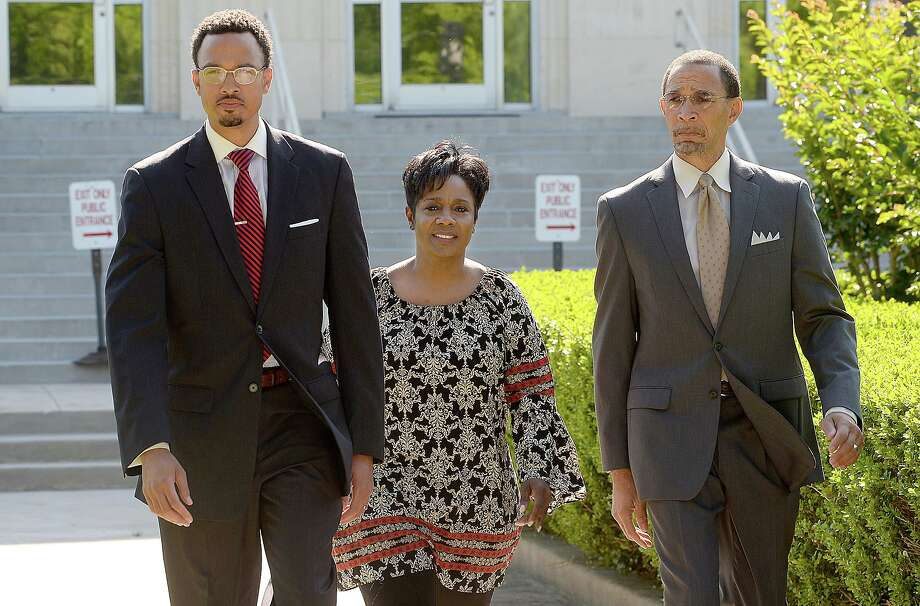 Jefferson County Sheriff Zena Stephens is flanked by attorneys Sean Villery-Samuel (left) and Audwin Samuel as she exits the Chambers County Courthouse where she addressed indictments on charges, including a felony charge, on campaign finance issues. Two other sheriff candidates, Ray Beck and Joe Stevenson, were also indicted. Photo taken Friday, April 27, 2018 Kim Brent/The Enterprise Photo: Kim Brent / Beaumont Enterprise / BEN