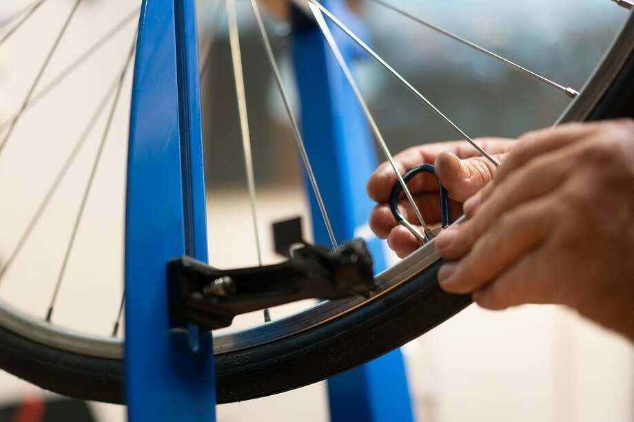 Jay Beaman trues a wheel in his converted dining room as he hopes to get more bicyclists on the road - and more people eager for a future San Francisco that puts bikes over cars on Wednesday, July 8, 2020 in San Francisco, Calif. Photo: Paul Kuroda / Special To The Chronicle