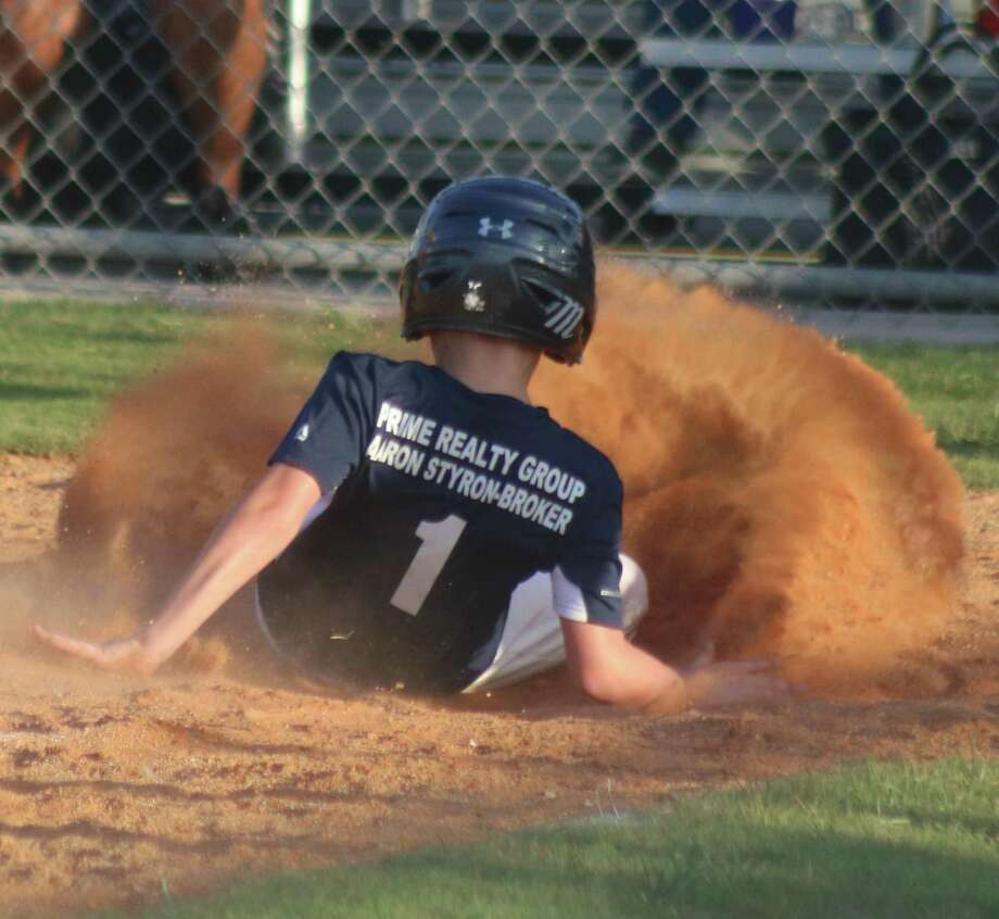 With a wall of dirt in front of him, Gage scores a tying run for the Astros in Thursday night's game. Photo: Robert Avery