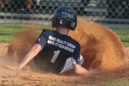 With a wall of dirt in front of him, Gage scores a tying run for the Astros in Thursday night's game.