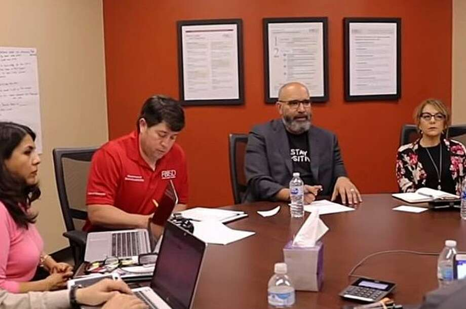 Fort Bend ISD superintendent Charles Dupre (second from right) meets with administrators to discuss online learning in a video posted to the district website on March 22. District officials are currently working on plans for re-opening schools under new guidelines recently announced by the Texas Education Agency. Photo: Fort Bend ISD