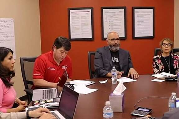 Fort Bend ISD superintendent Charles Dupre (second from right) meets with administrators to discuss online learning in a video posted to the district website on March 22. District officials are currently working on plans for re-opening schools under new guidelines recently announced by the Texas Education Agency.