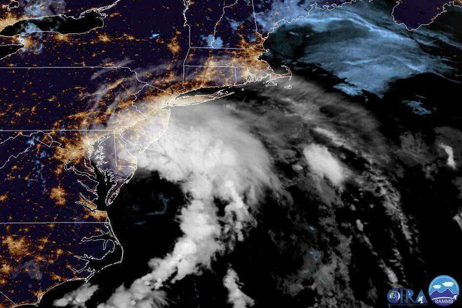 This GOES-16 satellite image taken at 9:30 UTC (5:30 a.m. EDT) on Friday, July 10, 2020 shows Tropical Storm Fay as it moves closer to land in the northeast of the United States. Fay was expected to bring 2 to 4 inches (5 to 10 centimeters) of rain, with the possibility of flash flooding in parts of the mid-Atlantic and southern New England, The U.S. National Hurricane Center said in its 5 a.m. advisory. (NOAA via AP)