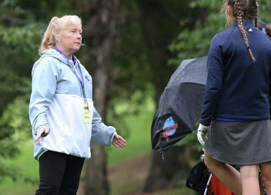 Marquette Catholic girls golf coach Deb Walsh (left) talks with Explorers sophomore Clancy Maag before she tees off in last season's Class 1A regional at Spencer T. Olin in Alton. Walsh is the 2019 Telegraph Girls Golf Coach of the Year. Photo: Greg Shashack | The Telegraph
