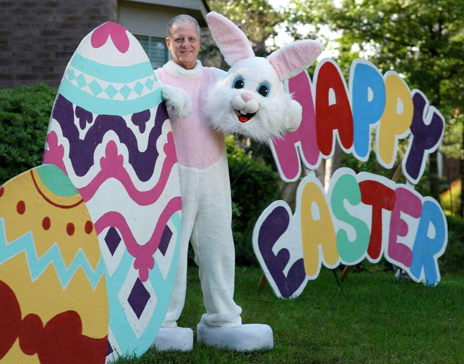 Michael Bisbee, dressed as the Easter Bunny, poses for a portrait outside his family's home, Saturday, April 11, 2020, in The Woodlands. Bisbee passed away unexpectedly on July 6. He was also training for the Ironman competition in The Woodlands and this week Ironman announcer Mike Reilly offered a special message to his family and friends. Photo: Jason Fochtman, Houston Chronicle / Staff Photographer / 2020 © Houston Chronicle