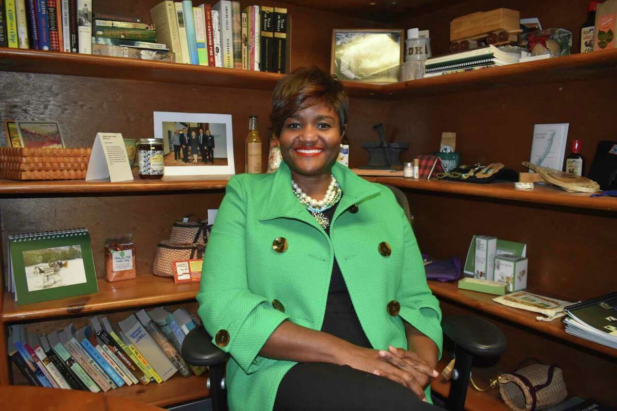 Adirondack Diversity Initiative Director Nicole Hylton-Patterson poses for a photo in her Saranac Lake, N..Y., office on Dec. 10, 2019. The Adirondack Daily Enterprise reports that Hylton-Patterson is moving out of Saranac Lake, citing racist graffiti on a railroad bridge that made her feel unsafe. She moved to Saranac Lake from the Bronx borough of New York in December 2019, to take the new position of director of the Adirondack Diversity Initiative, coalition of groups seeking to make the Adirondacks more welcoming and inclusive to all New Yorkers.