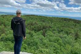 A hiker takes in the view from Mount Greylock in the Berkshires. The summit is at 3,491 feet and offers views of five nearby states due to its isolated location.