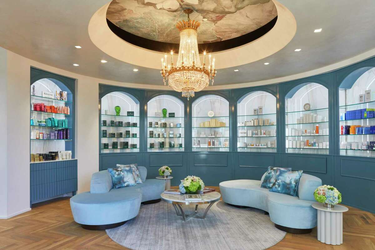 A calming blue welcomes guests to the sitting area of Solaya Spa & Salon, where products are available for purchase.
