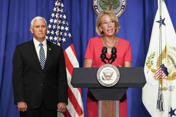 Vice President Mike Pence watches Betsy DeVos U.S. secretary of education, speak during a White House Coronavirus Task Force briefing at the Department of Education in Washington, D.C., on July 8, 2020.