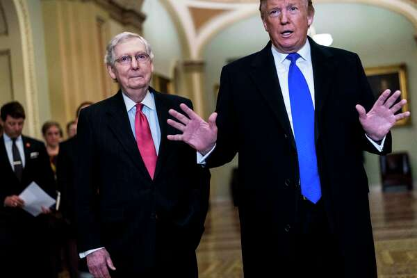 President Donald Trump speaks to journalists, accompanied by Senate Majority Leader Mitch McConnell in 2019.