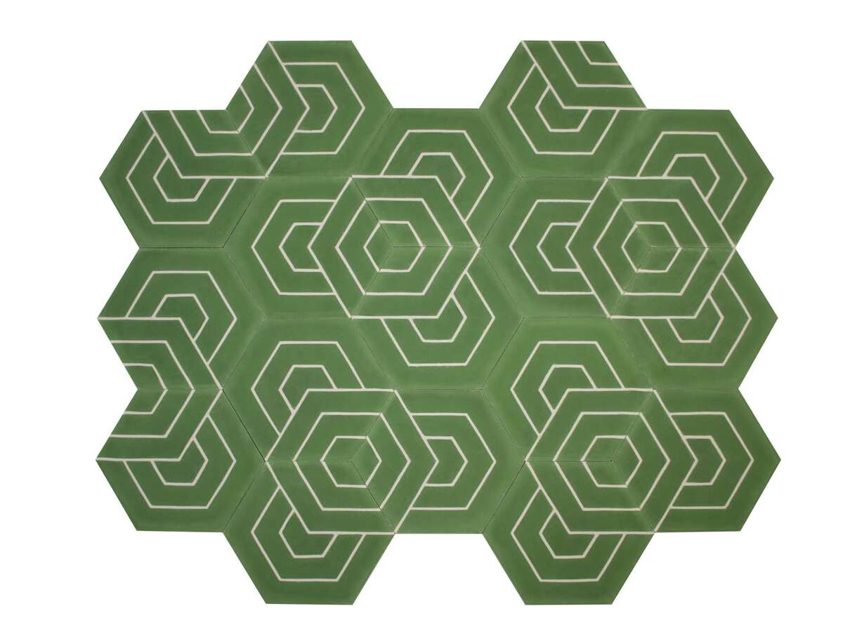 Popham Designs works with Moroccan artisans to hand-make cement tiles that combine traditional elements with modern patterns and bold colors that make any room pop. Price upon request; pophamdesign.com